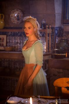 "Screenshot of Lily James as Cinderella in ""Cinderella"" - ""What was it you wanted to talk to me about?"" ""You...you don't have to listen, Monsieur, if you are busy or aren't interested. After all, I am just-"" ""Mademoiselle. I would not have come if I were not interested - and you would not have invited me unless you had something important to say. Now, please: what is it? Don't be afraid."""
