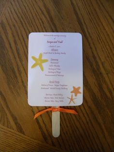 5x7 Wedding Fan Program Custom with Ribbons, Photo, and Die Cuts with Wooden Handle. $2.60, via Etsy.