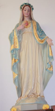 A statue of the Blessed Virgin Mary - these are still traditional in many Catholic homes. This status looks to have been crowned for May Crowning - a traditional rite.