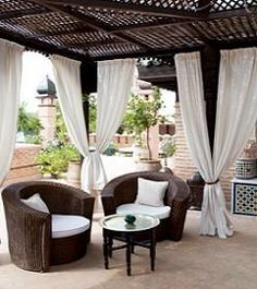 Dina Manzo used tension curtain rods to put up curtains temporarily in an outdoor room. They stapled down the edge of old/cheap bed sheets. Sold!