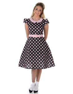 Disfraz vestido años 50 puntos rosas mujer: Este disfraz años 50 para mujer incluy vestido y cinturón (calcetines y zapatos no incluidos).El vestido es negro con puntos rosas.Tiene mangas cortas y cuello claudino rosa. Se cierra...
