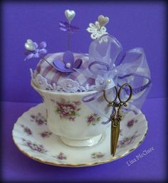 Pretty vintage cup and saucer pin cushion.