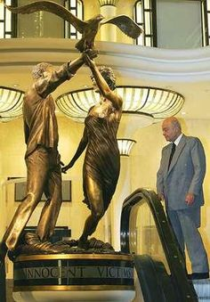 Mohammed Al Fayed with the statue of Princess Diana and his son