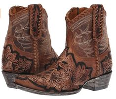 Brown tooled leather cowboy boots by Old Gringo.