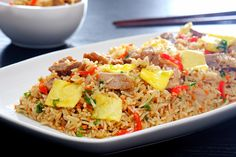 Arroz chaufa is a Cantonese-style fried rice dish imported to Peru, popular in the chifas of Lima. Scroll down for recipe.