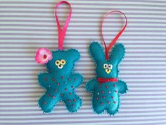 Set of 2 beautiful Christmas ornaments - a teddy bear and a bunny in teal color. Hand embroidered and hand stitched. Measures approximately 3.75 x 2.5.