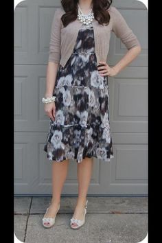 Blue and black floral print dress, tan cardigan, pearl jewelry. Modest spring fashion