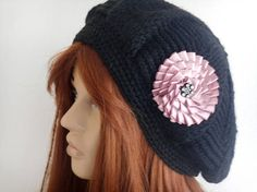 Women Knit Hat, Women Black Hat, Knitted Hat, Black Knitted Hat, Women Winter Hat, Hot Hat, Knitted Hat, Crochet Hat, Knitted Black Hats    Made of black wool yarn.  Cold winter keeps you warm in months.  Autumn winter fashion accessory.  Comfortable soft.  The flower on top adds elegance.  Removable portable flower.  You can combine it with your other clothes.  Color: Black Pink powder, removable flower.  gentle or hand wash in slightly warm water, do not dry, dry on a horizontal surface of…