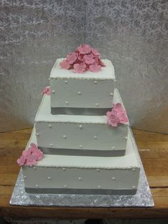 Silver and Pink Wedding Cake by Conti's Pastry Shoppe, via Flickr