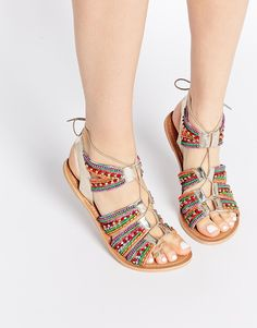 Image 1 ofASOS FOSS Leather Lace Up Beaded Sandals