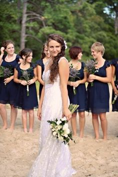 Bridesmaids in navy + lavender bouquets