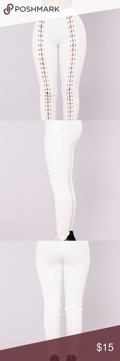 PLUS SIZE LACE UP PANTS STILL IN PACKAGING NEW NEVER WORN WITH TAGS IT HAS LIMITED STRETCH JUNIOR PLUS SIZE 3X IF U FIT A SIZE 2X YOU WILL BE ABLE TO FIT THESE Fashion Nova Pants Leggings