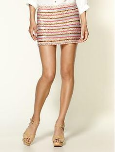 If I had legs like hers I would wear this adorable skirt every day. Tribal Beading Silk Skirt by Parker.