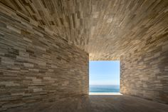 At the Solaz Los Cabos, a resort by Sordo Madaleno Arquitectos on Mexico's Baja California peninsula, a passageway sheathed in travertine marble frames a painterly view of the Sea of Cortés. Luz Natural, Baja California, Beach Club, Mexican Colors, Lafont, San Jose Del Cabo, Landmark Hotel, Mexican Artists, Arquitetura