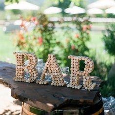 We've gotta ask you: what's your sign? Wait. Scratch that. We sound like a guy trying to pick you up from a dive bar. But if you're perusing our wedding sign obsessions, chances are you've already found your dream guy! So let's talk about that to-do list. If you've checked off the dress, invites and bouquet, the next step is some seriously savvy signage. Our picks are a little functional, a little lovey dovey and a whole lotta cute — it must be a sign!