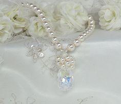 Pearl bridal necklace with Swarovski crystal teardrop nestled under a pearl cluster by MossRoseBrideJewelry #weddingjewelry #jewelryforbride #pearlnecklace #pearlwedding #crystalteardropnecklace #bridalnecklace