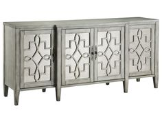 Stein World Lawrence 4 Door Credenza With Mirror Facing In Grey 47777   Stein World Lawrence 4 Door Credenza With Mirror Facing In Grey 47777Breakfront mirrored four-door credenza features antique mirrored glass set behind intricate open scroll fretwork. Also includes a fixed interior shelf, tapered legs, and a soft hand-painted grey finish.Sku: 47777Manufacturer: Stein WorldCollection: Accent Furniture