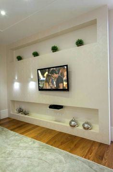 tv wall design as an office space accessory or as an ornament of a farmhouse living rooom design for your modern farmhouse style part 1 # farmhousedecor Tv Wall Design, Ceiling Design, Tv Wanddekor, Plafond Design, Living Room Tv Unit, Tv Wall Decor, Rustic Floating Shelves, Modern Farmhouse Style, Wall Mounted Tv