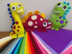 Colourful Felt Dinosaurs from Felt, Cotton and Whimsy. www.facebook.com/feltcottonandwhimsy