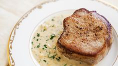 IMPRESSIVE Pork Chops with Dijon Sauce: 1 tbsp butter 1 tbsp olive oil 4 boneless pork loin chops (center cut rib or loin pork chops boneless or bone in whatever you prefer about 1 14 inch thick) salt black pepper (freshly ground) 14 cup green onion (chopped shallots) 1 cup dry white wine 34 cup chicken stock 34 cup heavy cream 2 tbsps dijon mustard 1 tbsp chopped parsley (optional)