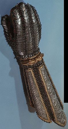 Indian splinted dastana / bazu band (arm guard), composed of five rectangular plates, each connected by bands of mail terminating in an articulated gauntlet.