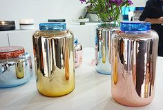 glass jars spraypainted with metallic paint...