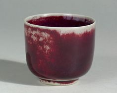 Porcelain tea-cup with oxblood glaze, made by Laura Andreson in 1979
