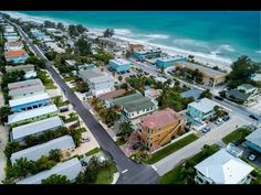 Enjoy a relaxed Island getaway with coastal charm in this cheery four-bedroom, four-bath elevated Duplex just a block from the beach! Bradenton Beach, Parasailing, Back Patio, Gulf Of Mexico, White Sand Beach, Guest Bedrooms, Beach Cottages, Coastal, Tours