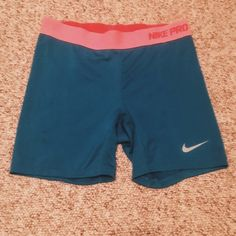 Nike shorts Blue & Pink Nike compression shorts. Great condition, just too small for me! Size XL Nike Shorts