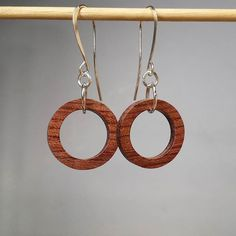 Here is a clearer shot of the Bubinga tiny hoops.  #earrings #woodearrings #mackeyartistry #jewelry