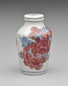 An Underglaze Blue, White and Red Porcelain Snuff Pot