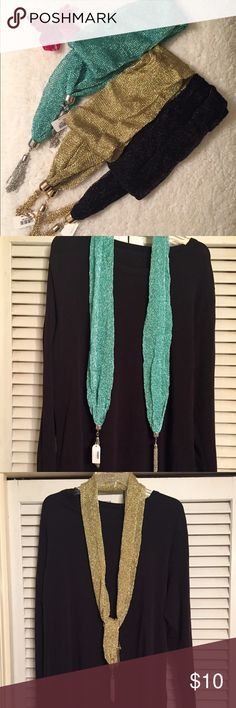 Icon collection These scarf comes in three beautiful colors. The colors are sky blue with silver tassel, black and gold  w/gold tassels. Nice look. Measures 42 inches between tassels. Icon Collection Accessories Scarves & Wraps