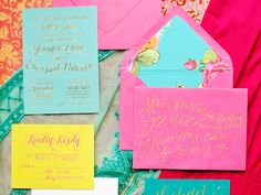 Colorful Gold Foil Calligraphy Wedding Invitations via @Oh So Beautiful Paper: http://ohsobeautifulpaper.com/2013/10/jennifer-erics-colorful-gold-foil-calligraphy-wedding-invitations/ | Design + Calligraphy: Jenna Blazevich | Invitation Printing: Margot Madison | Day-of Stationery Screen Printing: Cryptogram | Photo: Jenna Blazevich #calligraphy #floral #goldfoil #wedding