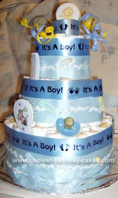 """Homemade """"It's a Boy"""" Diaper Cake Idea... This website is the Pinterest of diaper cake ideas"""