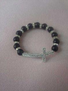 Black sideways cross