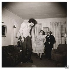 Diane Arbus, A Jewish giant at home with his parents in the Bronx, N.Y.C.