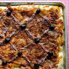 Pissaladiere, a flatbread from the South of France, is a great recipe idea for the summer picnics since it can be eaten hot, cold than lukewarm.