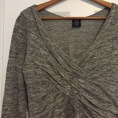 ANTHROPOLOGIE Astars Top Great Astars tunic top from Anthropologie. Very soft grey marled-knit v neck top with ruching. Size Large. Anthropologie Tops