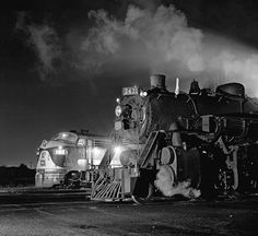 Old steam train next to a more modern diesel powered train by Photographer Jim Shaughnessy.