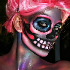 Beautiful sugar skull makeup with pink hair.  Sparkly!