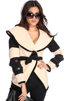 When the cold comes in, keep things toasty with this eye catching coat! Shop for unique, one-of-a-kind items only here at AMI! Youll sure make a fashion statement when you walk out this winter! It features two tone, folded collar, v neck, adjustable waist tie, buckle strap long sleeves, and fitted. 100% Polyester.