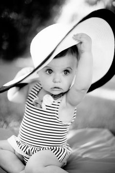 Adorable little girl. Black and white is totally unexpected for pictures of kids