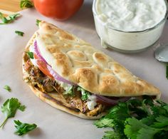 Chicken Gyros with Homemade Tzatziki Sauce - pickled onions. Use different tzatziki recipe