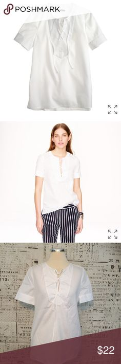 """NEW J Crew White Lace Up Tee Sz 2 J crew white lace up  PRODUCT DETAILS Safari style meets sophisticated tailoring in this clean-lined lace-up shirt. It's our polished alternative to the classic T-shirt. * Cotton. * Functional buttons at cuffs. * Front slit with tie closure. * Machine wash. * Import. * Item A4986.  Measures 16.5"""" across bust Length measures 26.5"""" Length from under arm to hem: 18""""    /344/ J. Crew Tops Blouses"""