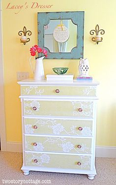 Lacey's wallpaper covered dresser with @Hobby Lobby knobs