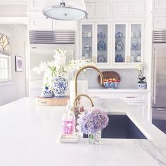 blue and white jars  //  bowl  // orchid // brass hardware     round butcher block  // marble soap tray  // soap   I get a lot of quest...