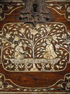 A Mughal ivory-inlaid wood fall-front cabinet with figures, Gujarat or Sind, 17th century
