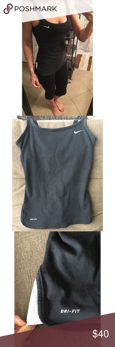 Nike dri-fit tank Nike dri-fit tank. Size Small. Black with white detail. Built in bra. Gently used/great condition. Nike Tops Tank Tops