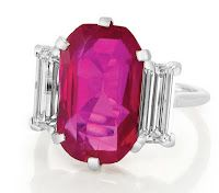 Cartier burma ruby ring.  On April 13th a 6.29 ct. Burmese Ruby three stone ring made by famed jewelry house Cartier, recently sold at Doyle's New York Jewelry auction. The ruby and diamond ring was set in platinum and flanked on either side with elongated straight diamond baguettes. This is an astonishing price because this ruby sold at over two hundred thousand per carat. This goes to show how expensive natural rubies are.  $1,320,000