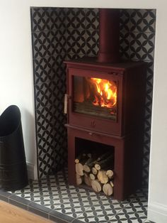 Excellent Free Fireplace Hearth log burner Tips Woodburner and retro tiles- The Over To You Ginger House Wood Burner Fireplace, Wood Burning Fireplace Inserts, Tv Over Fireplace, Fireplace Pictures, Fireplace Hearth, Living Room With Fireplace, Fireplace Surrounds, Fireplace Design, Tiled Fireplace